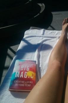 Lounging and reading Big Magic