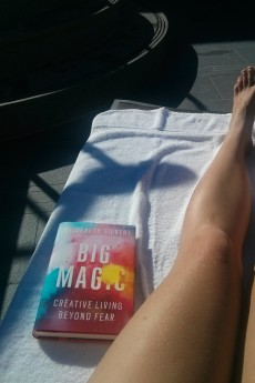 Lounging and reading Big Magic